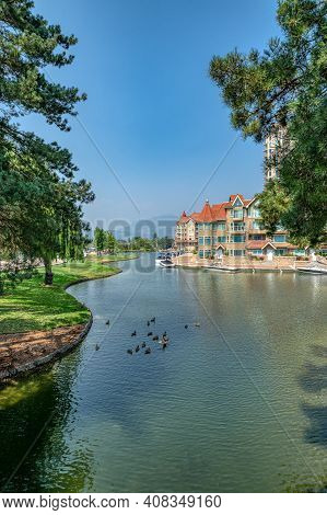 Ducks In Front Of Luxury Residential Area With Boat Pier At The Entrance