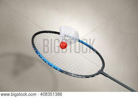 Shuttlecock And Racquet On Light Background. Badminton Equipment