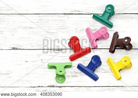Colorful Paper Clips On White Grunge Wooden Table  ,colorful,design,document,education,equipment,fas