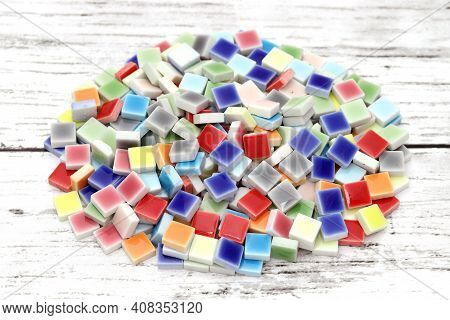Stacked Of Colorful Tiles On White Wooden Table