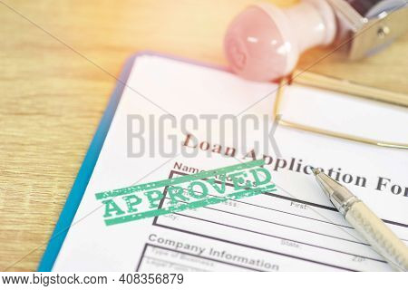 Loan Approval, Loan Application Form With Rubber Stamping That Says Loan Approved, Financial Loan Mo