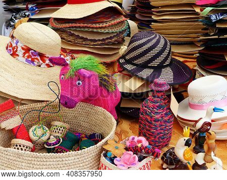 Colorful Handmade Souvenirs From Straw - Panama Hats Or Paja Toquilla Hats Or Sombrero, Baskets And