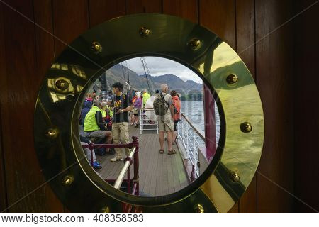 Queenstown New Zealand - March 2 2015; Group Of Mainly Seniors On Deck Sailing On Ship Across Lake W