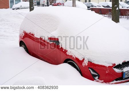 Snowed-in Cars In A Street In The City Center Of Magdeburg In Germany In Winter
