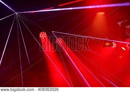 Laser And Led Stage Lighting Fixtures At The Show. Selective Focus.
