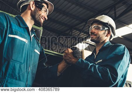 Two Skillful Factory Engineer Or Worker Showing Teamwork And Partnership . Industrial People And Man