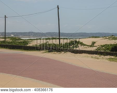 Paved Promenade With Dunes Behind At Durban Beachfront