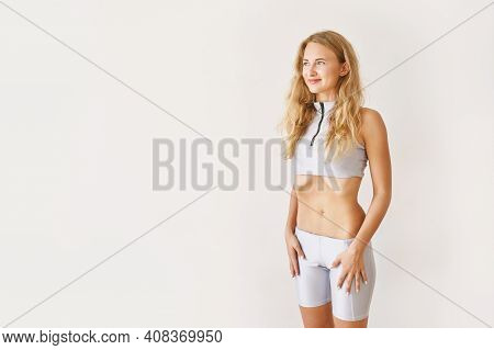 Young Pretty Woman Breathing Exercise. Home Sport Workout. Healthy Lifestyle. Long Blond Hair. Smili