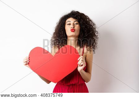 Romantic Woman In Dress Showing Big Red Heart, Pucker Lips For Kiss And Express Love, Express Sympat