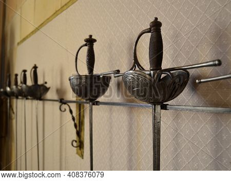 Stored Sabers And Swords Hanging On The Wall For Display