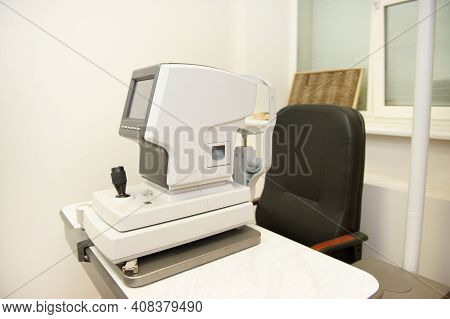 The Device For Checking The Vision Of A Person Is In The Office Of An Optometrist