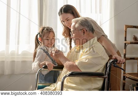 Asian Senior Man Was Sick And Sitting On Wheelchair. Retirement Age Lifestyle And Togetherness With