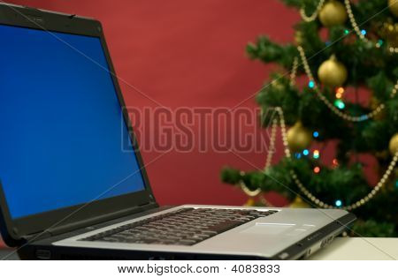 Laptop And Christmas Tree