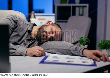 Hardworking Entrepreneur Sleeps On Table At Workplace Because Of Deadline. Workaholic Employee Falli