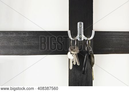Car Keys And House Keys On A Hanger. New Reality. Car Keys On A Hook With Space For Text (copy The S