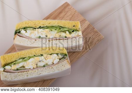 Close Up Image Of Two Slices Of Egg Salad Sandwich.