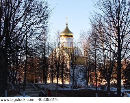 Orthodox Church With A Gilded Dome In The Middle Of The Park.