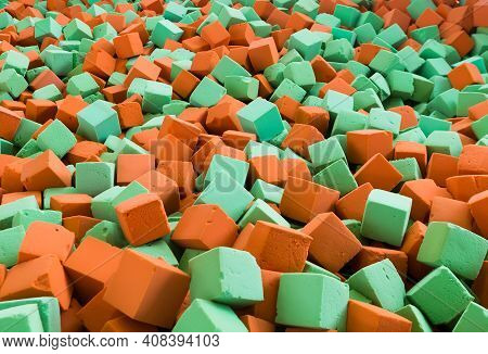 Background With Bright Red And Green Soft Blocks Or Cubes. Multicolored Geometric Background.