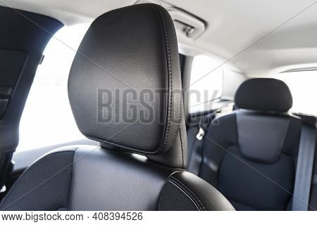 Modern Luxury Car Black Leather Interior. Part Of Perforated Leather Car Seat Details With White Sti