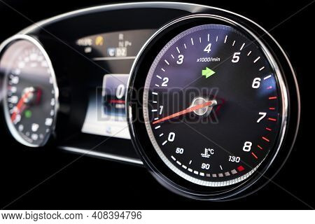 Close Up Shot Of A Tachometer In A Car. Car Dashboard. Dashboard Details With Indication Lamps. Car