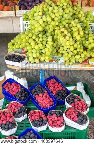 Large Bunches Of Succulent Green Grapes Displayed Above Tubs Of Raspberries At Kotor Market,monteneg