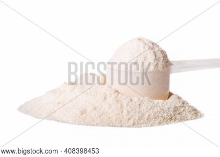 Heap Of White Protein Powder With Measuring Spoon Isolated On White Background.