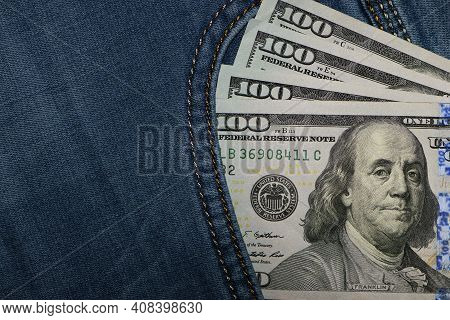 Money, Dollar Bills In Jeans Pocket. Us Dollars Are Visible In Your Pocket. 100 Dollar Bills, Out Of
