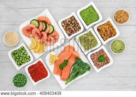 Low glycemic food for diabetics for healthy eating with all foods below 55 on the GI scale and  high in antioxidants, fibre, protein, omega 3, vitamins  minerals. Health care concept. On rustic wood.