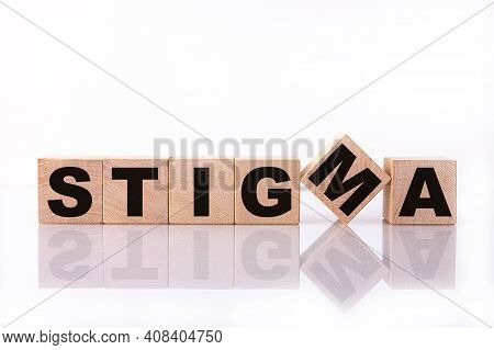 Stigma Word, Text, Written On Wooden Cubes, Building Blocks, Over White Background With Reflection.