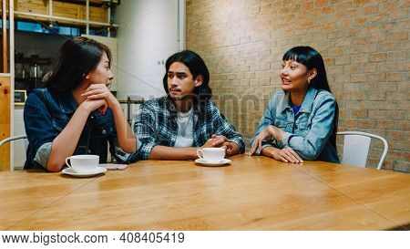 Group Of Happy Young Asia Friends Having Fun A Great Time And Laughing Enjoying Meal While Sitting T