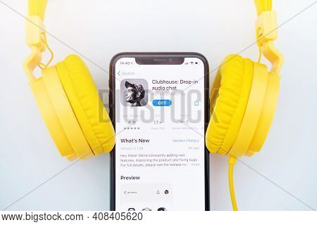February 16, 2021, Russia, Orenburg: Iphone And Yellow Headphones On A White Background.