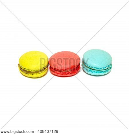 Yellow Red Blue Macaroons Isolated In White Background. Colorful French Macarons Close-up. Tasty Swe