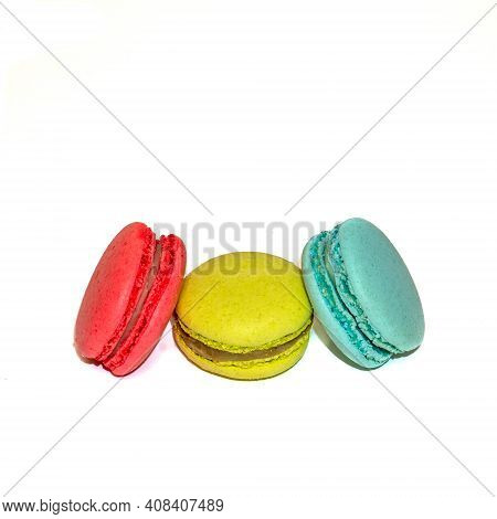 Macaroons Isolated In White Background. Colorful French Macarons Close-up. Tasty Sweet Color Macaroo