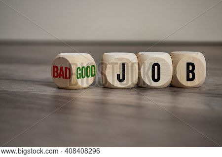 Cubes, Dice Or Blocks With Messages Bad Job And Good Job On Wooden Background