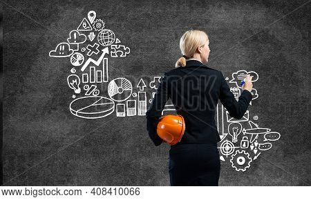 Businesswoman Draws Arrows Consists Of Business Doodles On Blackboard. Personal Success And Career A