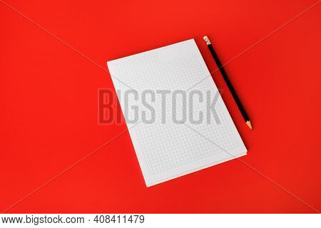 Blank Copybook And Pencil On Red Paper Background. Blank Branding Template. Blank Stationery. Mockup
