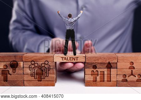 Business, Technology, Internet And Network Concept. Young Businessman Shows The Word:talent