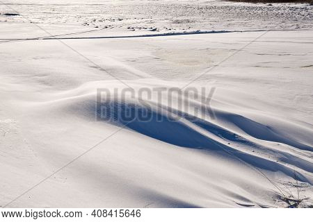 Textured Snow Patterns And Snowdrift On The Ground In A Wintry Landscape