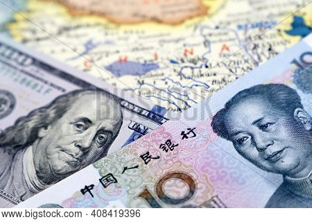 Us Dollars And Chinese Yuan On The Map Of China. Trade War Between Us And China, Economic Sanctions