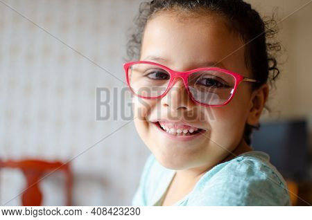 Little Girl Sipping At Home, In Brazil The Beautiful Smile Of A Little Girl At Home Due To The Pande