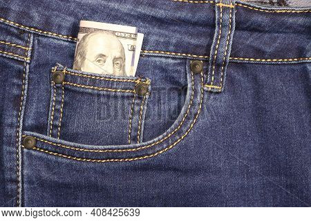 Stack Of American Hundred Dollar Bills In A Pocket Of Blue Jeans. Money In Your Pocket, Cash.