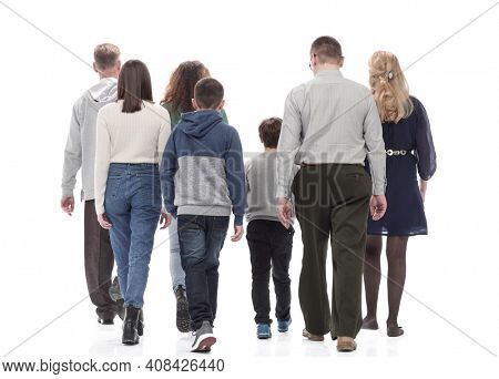 rear view. happy family in casual clothes walking forward.