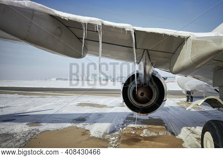 Selective Focus On Cicles From Airplane In Frosty Day. Grounded Plane At Snowy Airport. One Of The S