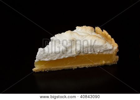 Slice of Lemon Meringue Pie on black background poster