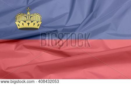 Fabric Flag Of Liechtenstein. Crease Of Liechtensteiner Flag Background, Blue And Red, Charged With