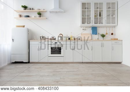 Light Kitchen In Daylight, Simply, Minimalist Scandinavian Interior. White Furniture, Small Refriger