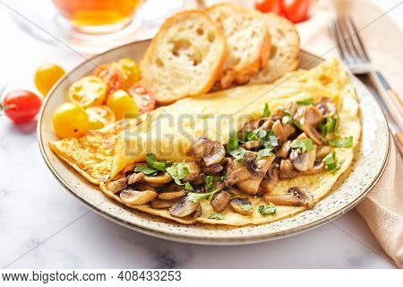 Omelet With Champignons And Parsley In Plate On Marble Background. Frittata - Italian Omelet For Bre