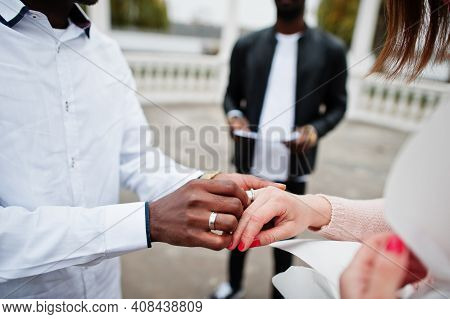Wedding Engagement Ceremony With Pastor. Multiethnic Couple Put Ring Each Other. Relationships Of Af