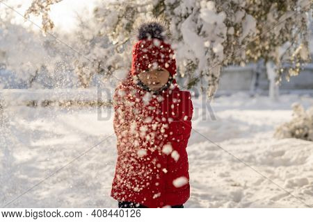 Baby Playing With Snow In Winter. Little Toddler Boy In Red Jacket And Xmas Reindeer Knitted Hat Cat