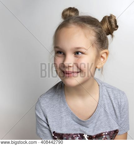 Happy Smiling Little Girl Studio Headshot Portrait Isolated On Grey Background. Beautiful Lovely Cau